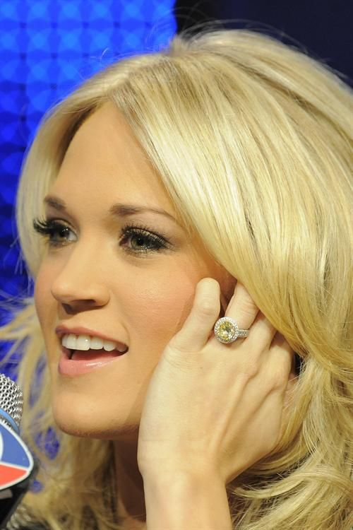 Carrie Underwood's round pale yellow diamond. Yup. Her husband did a good job.