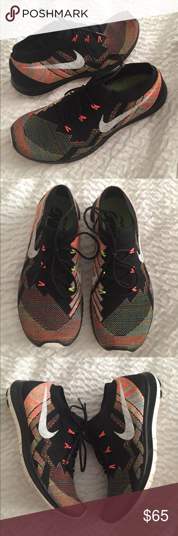 Nike free flyknit Like new black and multi color Nike free flyknit. Size ladies 7.5. Worn twice. Nike Shoes Sneakers
