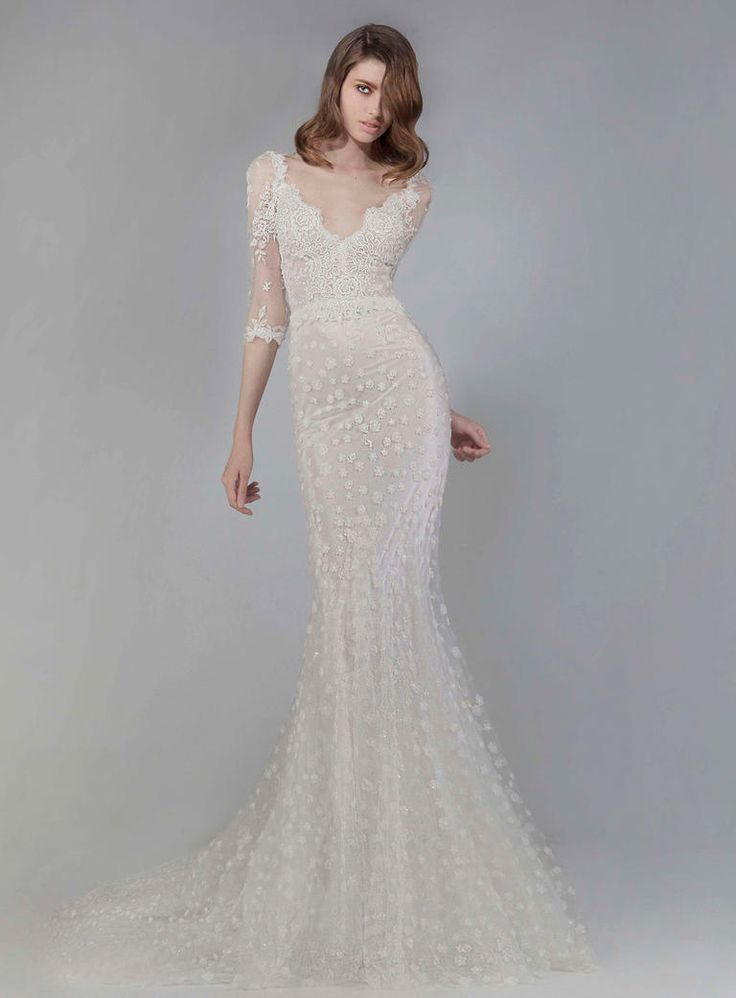 Victoria KyriaKides mermaid style wedding dress with polka dot floral appliques and sheer half-sleeves Fall 2016   https://www.theknot.com/content/victoria-kyriakides-wedding-dresses-bridal-fashion-week-fall-2016