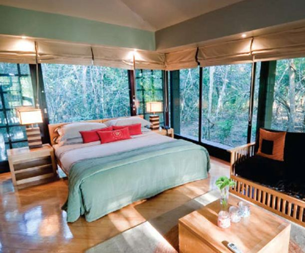 """/This Week's Best Ecolodge is…    *Phinda Forest Lodge, South Africa*    Built in 1994, Phinda Forest Lodge in Kwazulu-Natal, South Africa is a unique, comfortable place to relax or stage a photo safari in the private game reserve. The lodge is 19 miles west of the Indian Ocean and borders the Greater St. Lucia Wetland Park...""""    Do read more here: http://www.thedailygreen.com/living-green/best-eco-lodges#slide-12"""