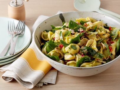 Get this all-star, easy-to-follow Spinach Artichoke Pasta Salad recipe from Rachael Ray