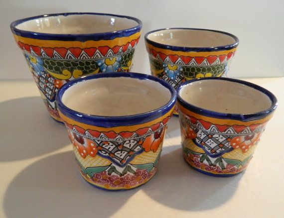 Unique Set of 4 Talavera pottery with heart design and embossed painting.