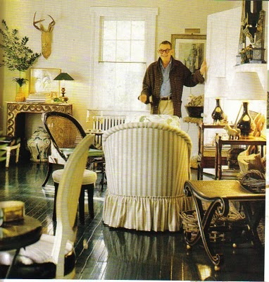 Albert Hadley's Southport living room with dark floors, striped furniture
