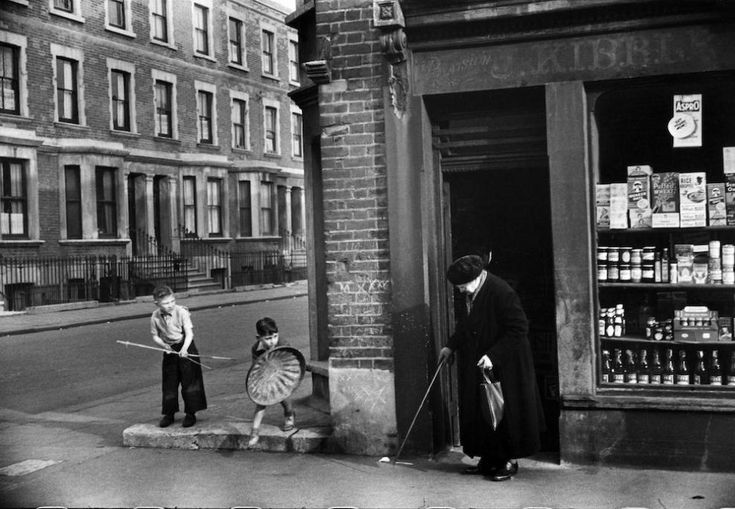Ah, the days when a home made bow and arrow and a bin lid meant hours of fun! - London, East end, 1954 Photo : Marc Riboud