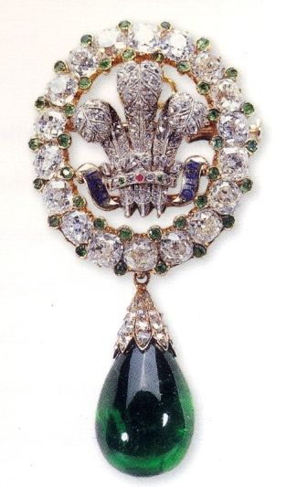 "Books, Birkins and Beauty: More On The Prince of Wales Feathers Brooch with emerald pendant. The brooch was a wedding gift to Princess Alexandra (later Queen Alexandra) from the ""Ladies of Bristol"" on the occasion of her wedding to the Prince of Wales (later King Edward VII) on 10 March 1863. It consists of an oval of 18 brilliant-cut diamonds accented with tiny emeralds, encircling the Prince of Wales ostrich feathers, set with diamonds, and a scroll inscribed with the Prince of Wales motto…"