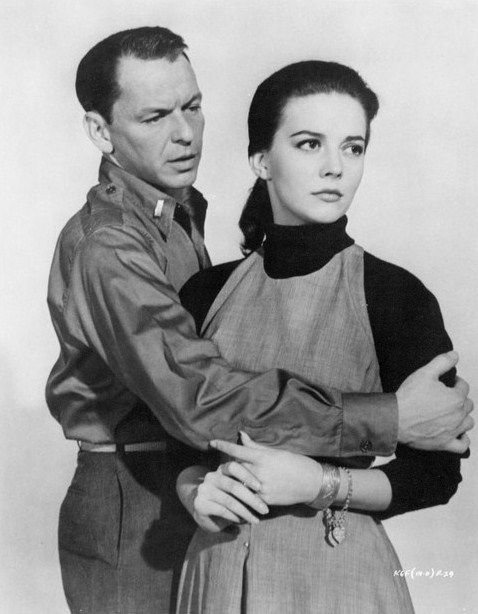 "Frank Sinatra and Natalie Wood in a dramatic scene from ""KINGS GO FORTH"" (1958)."
