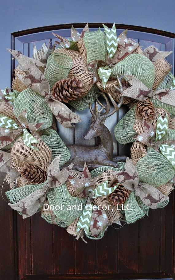 The winter deer wreath adds a rustic touch to any cabin or lake house. Accented with burlap and jute ribbon and a resin distressed look deer, this
