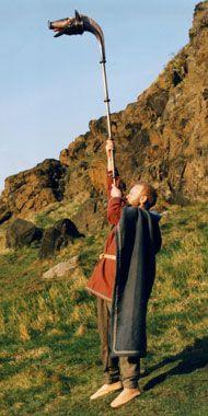 """Musician John Kenny playing the replica carnyx."" Celtic war horn."