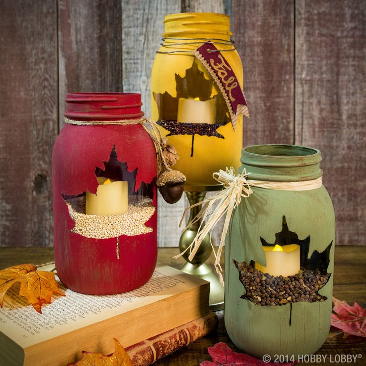 Stencil out leaf design before painting mason jars with chalk paint. This peek-a-boo craft is sure to please your Thanksgiving guests!:
