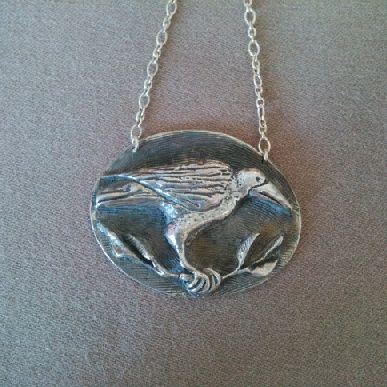 This #Raven #pendant was lovingly #handcarved by #Tara Shelton and cast into #sterling silver. Price $265 CDN. See more of #artisan Tara Shelton's #jewelry #jewellery at #ArtisansAtWork/ #AAWGallery www.aawgallery.com and www.tarashelton.com