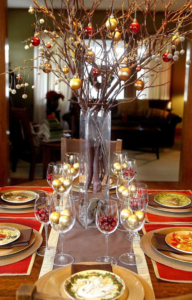 Luxury Christmas Party Centerpiece Idea with Gold Christmas Balls in the Glasses and Brown Tree Branches with Red and Gold Christmas Baalls -