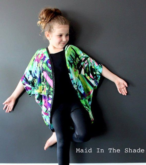 The Girls Batwing Kimono is an easy fit outer garment featuring a Batwing sleeve design that creates a soft drape around the body. Its a fast and easy to sew little jacket style, perfect with our Flat Front Gathered Skirt (pictured), at the beach & even in Winter over jeans.  Trim