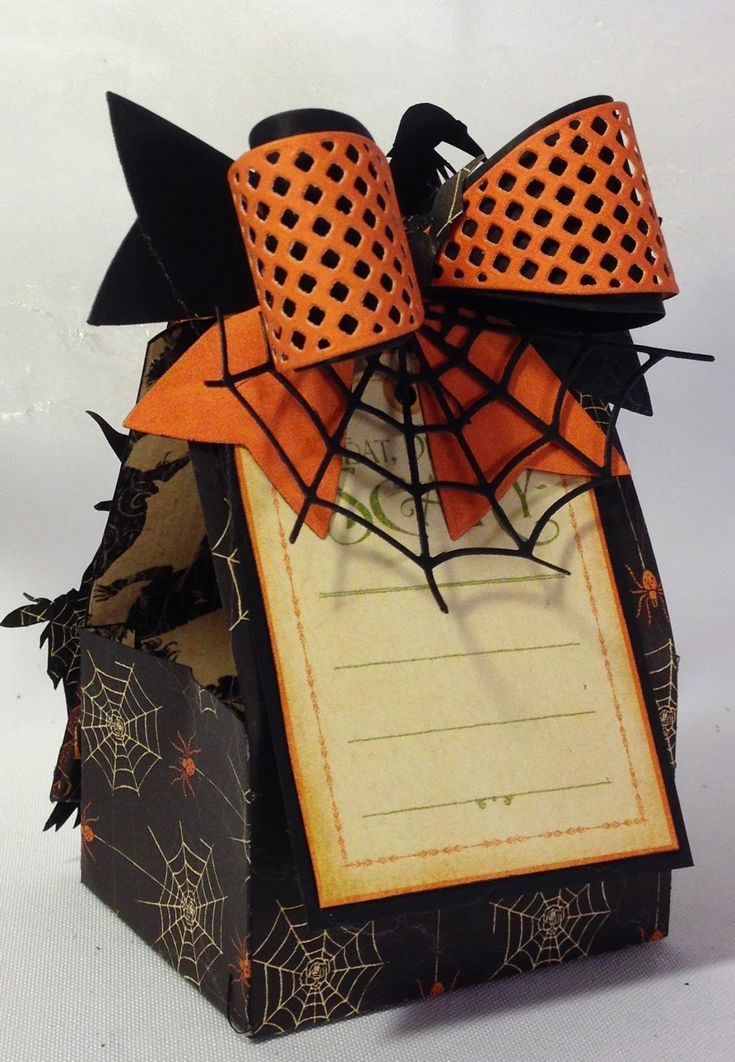 G 45 An Eerie Tale tag treat bag made with the tag shape on the backside of the new 12 x 12 papers and Marianne Design bow die By Anne Rostad