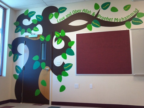This removable wall decal of a tree can be customized AT NO EXTRA CHARGE.    In the example, it's for an Islamic school but it could say anything you wish for your classroom.