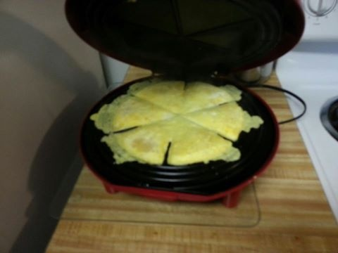 Scramble eggs and cheese and poor into quesadilla maker....Genius!!!