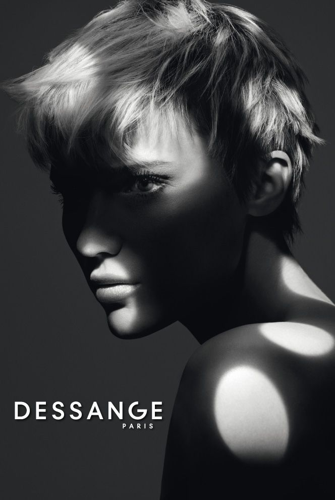 Short and androgynous: This short cut allows a few locks of hair to fall naturally into place. The longer top section encourages the creativity of a tailor-made hairstyle. This androgynous look is enhanced with glamorous feminine makeup. #DESSANGE #Collection #FallWinter #LightOfShadows