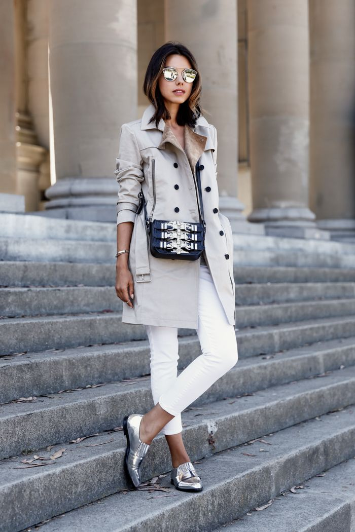 trench coat + black and silver purse + white skinny jeans + silver loafers