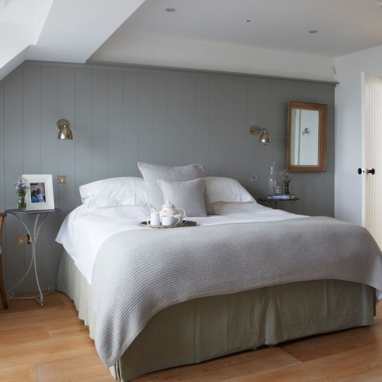 This bedroom is chic, uncluttered and awash with a palette of tranquil greys. Create a coastal feature wall and do away with the need for a headboard with tongue-and-groove panelling painted in a slate grey