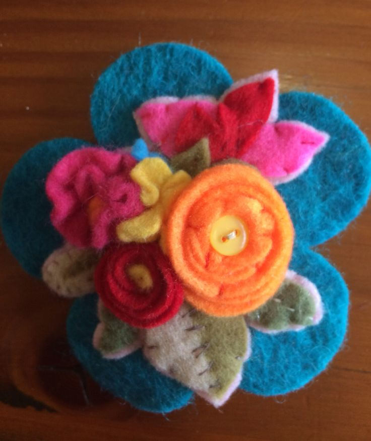 Wee brooch I made with some inspiration from a vintage felt design I saw on a tea cosy!!! I will try and find it.  Keywords: vintage; felt; brooch; applique