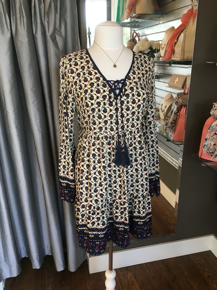 Long Sleeve Cream/Navy Boho Tunic/Dress - This is a beautiful long sleeve tunic/dress that is perfectly light weight for summer. The adorable tassel detail at the neckline makes this an eye catching piece for any summer wardrobe (Long Sleeve Cream/Navy Boho Tunic/Dress $68CAD) #summer #summerstyle #fashionista