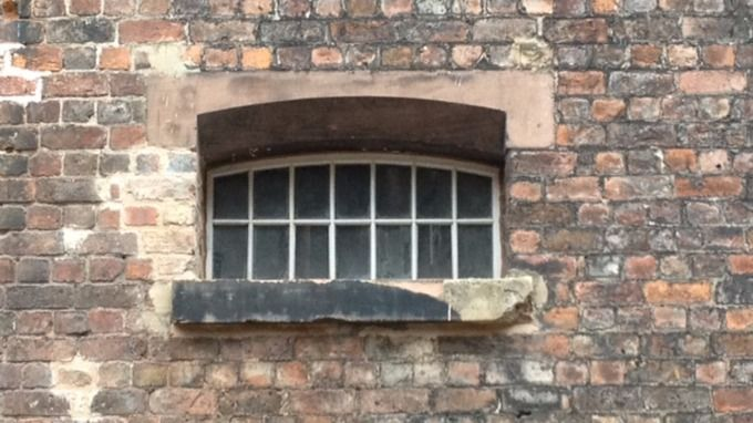 An image of the barred windows at the former Bridewell prison.