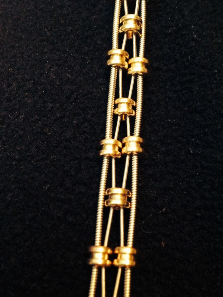 New design!  Guitar string bracelet with gold ball ends.