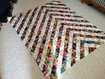 Maker of this quilt used up all her scraps, small and medium. So different and beautiful.
