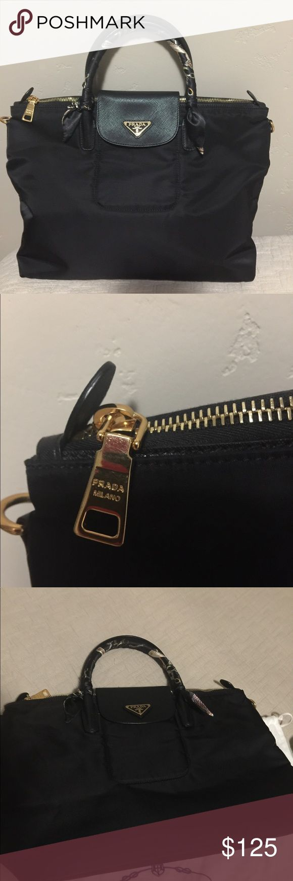Prada Tessuto Saffiano Medium Bought from online seller. Has some issues with the glazing on one of the handles. Photo attached for reference. In excellent condition. Price reflects status. Not real. Seller calls it authentic quality. Preloved. Prada Bags Crossbody Bags