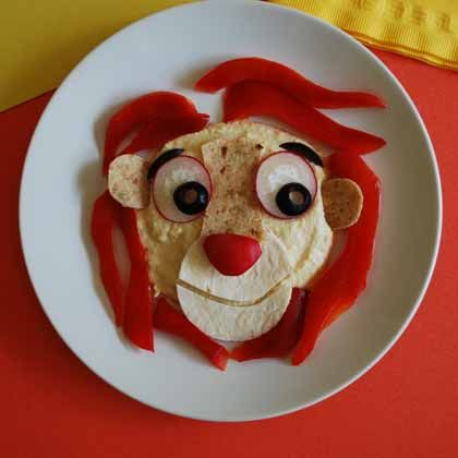 Protein rich and delicious, hummus with a bell pepper mane in the shape of Simba is the king of snacktime!