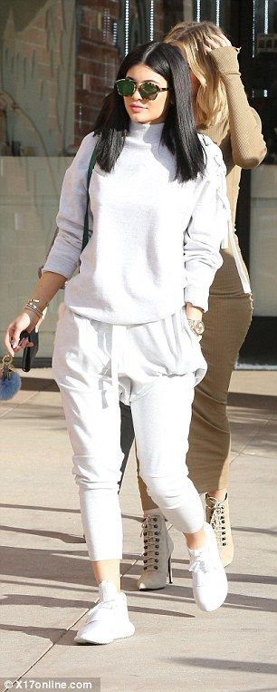Final touches: Keeping with her sports luxe look, Kylie added a pair of white Adidas Tubular Defiant sneakers
