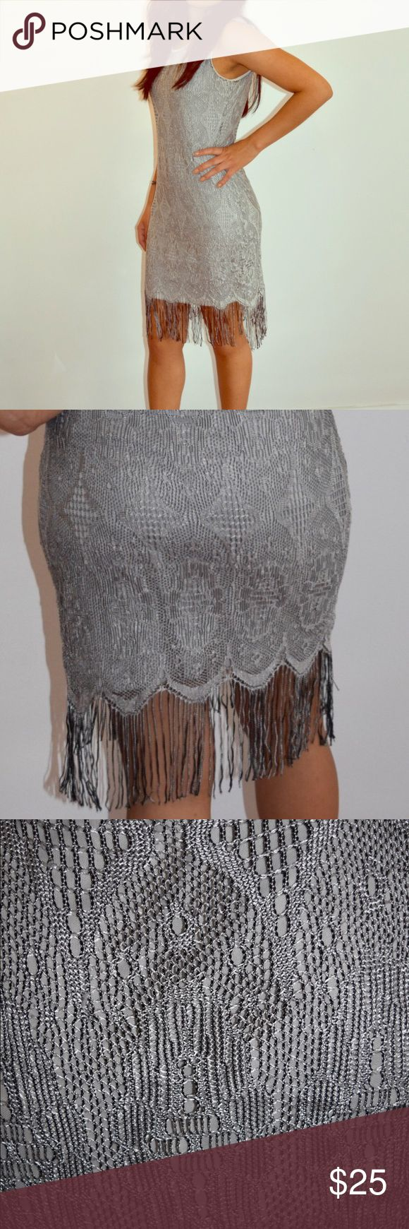 Venus Flapper Girl Dress or Bathing Suit Cover Grey and silver crochet/lace overlay dress. It is light and airy and is a great transition dress for a sexy day at the beach or a fun night out. Venus Dresses
