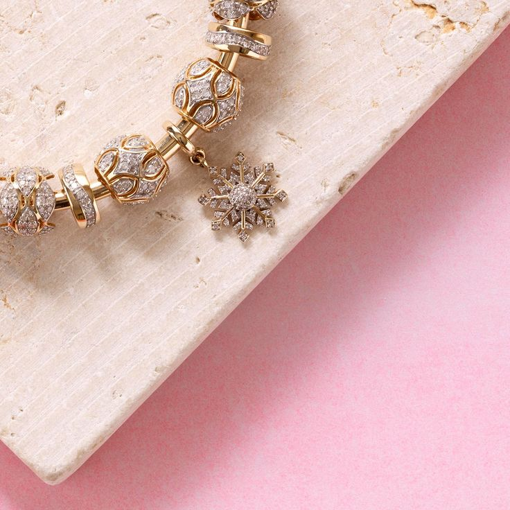 10ct gold & diamond bangle & limited edition charms. Exclusive to #emmaandroe #michaelhill. Available late November.