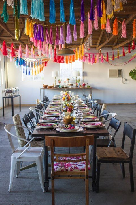 Love the bright coloured tassle garlands, and the table decor! ~ Hollie @ Little Goldfish