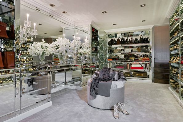 Luxurious Master Closet With Incredible Mirrored Island