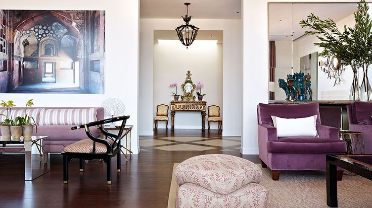Living Room With Plum Velvet Armchairs And A Mirrored