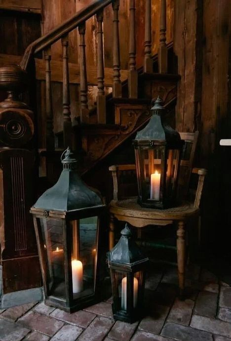 Obsessed with that warm wooden staircase and the rough brick floor, as well as the old lanterns. Reminds me of a dark fairytale.