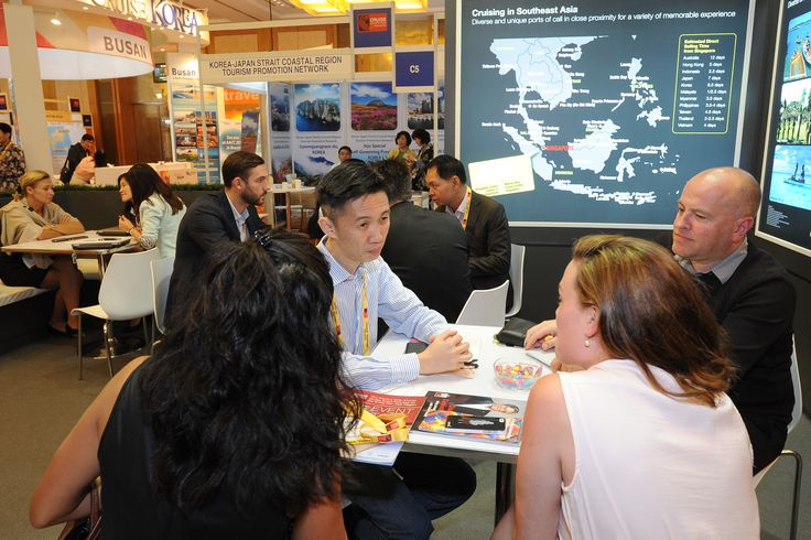 Meetings taking place at various booths on the show floor with exhibiting companies at Cruise Shipping Asia-Pacific