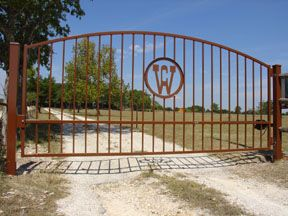 Custom iron driveway gates texas, solar automatic gate operator texas, gate opener texas, metal gate texas.