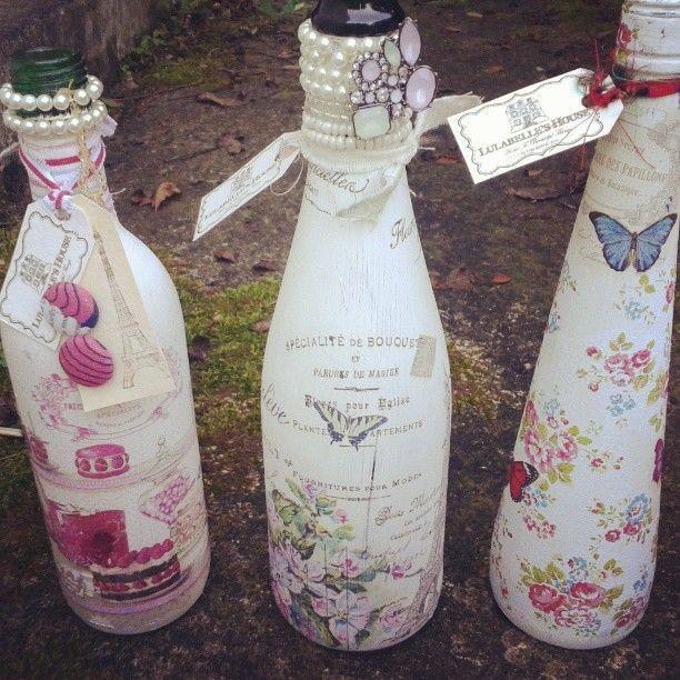 Wine bottles (empty of course!) painted with Lulabelle's House paint and decoupaged using paper napkins. Then added old pieces of jewelry for a bit of sparkle. Great for wedding table decorations