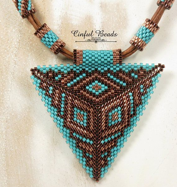 A very unique leather necklace that features a beautiful peyote stitched triangl…