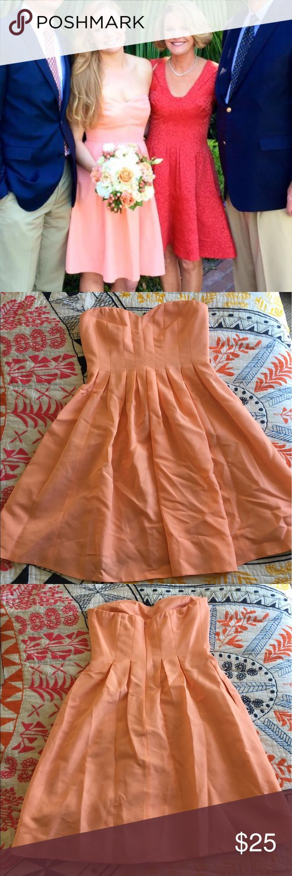 Jcrew Coral strapless dress Super cute worn one time salmon/coral dress super unique has pockets can wear multiple times I were as a bridesmaid gown J. Crew Dresses Mini
