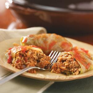OLD FASHION CABBAGE ROLLS: 1 medium head cabbage (3 pounds) 1/2 pound uncooked ground beef 1/2 pound uncooked ground pork 1 can (15 ounces) tomato sauce, divided 1 small onion, chopped 1/2 cup uncooked long grain rice 1 tablespoon dried parsley flakes 1/2 teaspoon salt 1/2 teaspoon snipped fresh dill or dill weed 1/8 teaspoon cayenne pepper 1 can (14-1/2 ounces) Hunt's® Diced Tomatoes, undrained 1/2 teaspoon sugar