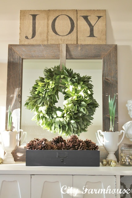 Fresh Bay wreath over barnboard mirror & handmade JOY sign.