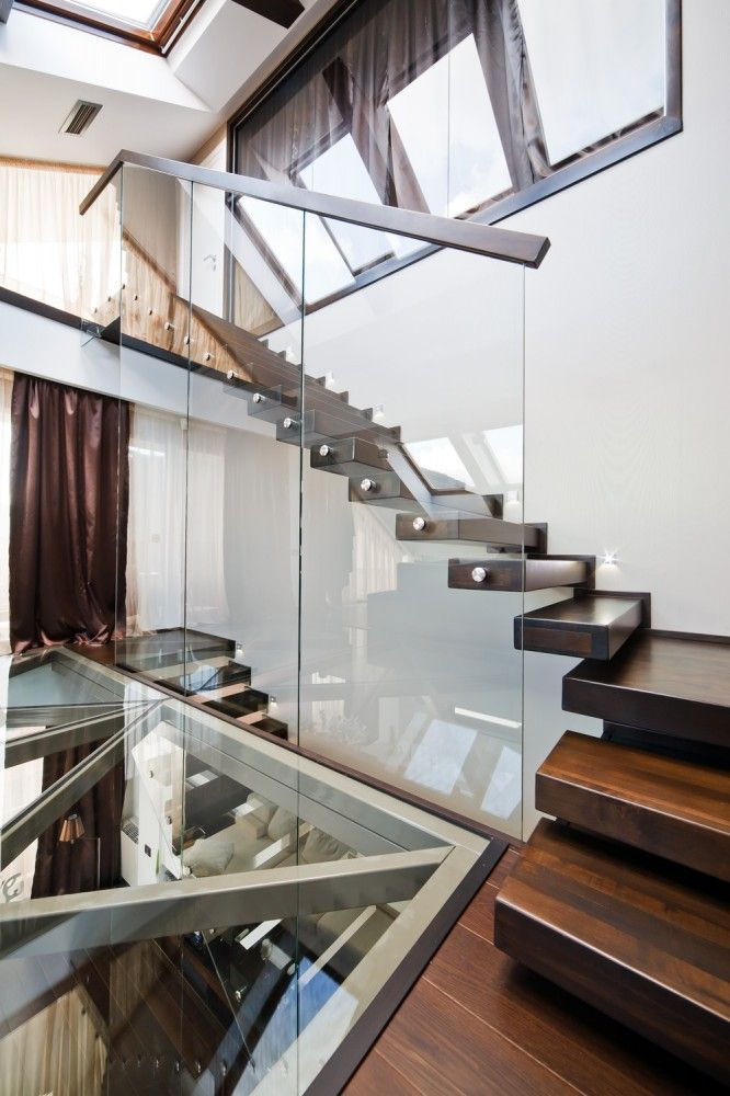 Clean, streamlined, gorgeous loft design.  The floating stairs are the perfect element here.