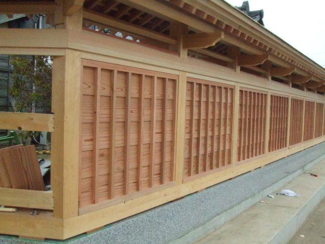 Elaborate Japanese garden fence under construction.