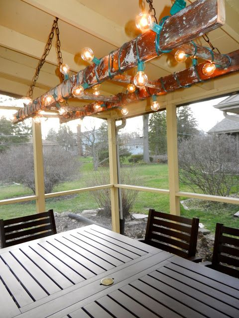 Turn an old ladder into an outdoor light fixture using string lights! LOVE THIS!