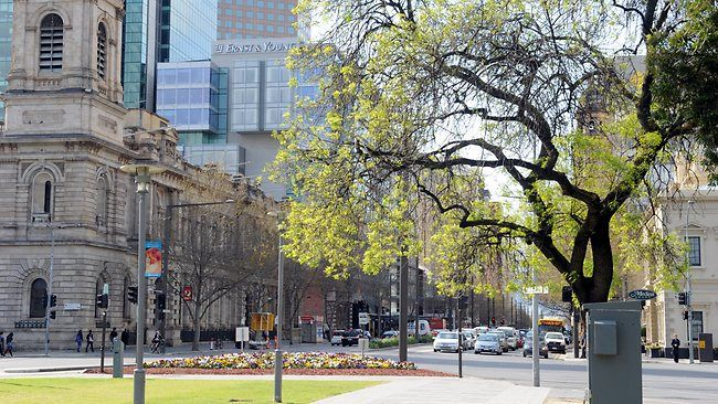 Adelaide is one of the world's great small cities and an Aussie leader in future liveability. South Australia. PHOTO: Victoria Square - Looking towards King William St. GPO clock tower on left, and town hall clock on right.
