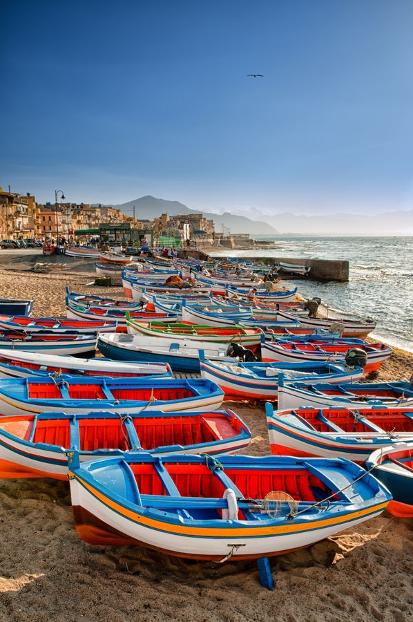"""Aspra is a beautiful seaside village east of Palermo, about 3 Km (1.9 mi) from the nearest town, Bagheria. Every morning a charming fish market run by local fishermen sells fish and seafood caught fresh from the bay on board the characteristic wooden colorful fishing boats olso called """"Lancitiedde"""" in sicilian. #tpalermo #sicily #sicilia"""