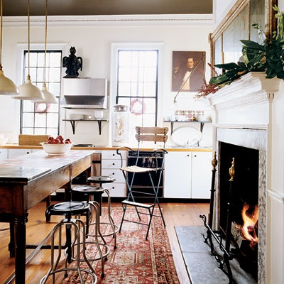 I love the idea of fireplaces in kitchens...it brings back the original intent of the room itself...people coming together around a hearth to share a meal. There's something very cozy and comforting about that that I just really resonate with.