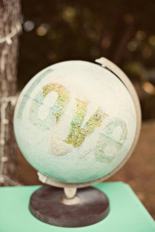 painting white over the globe except for the letters.... I think this is really pretty but I wouldn't be waste the globe